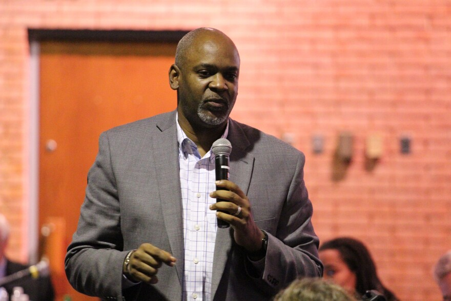 """Damon Lynch III helped hammer out Cincinnati's collaborative agreement. He told the crowd his city broke through once blacks and whites started seeing each other through their own """"lenses."""""""