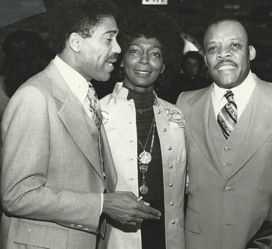 U.S. Rep. Bill Clay and Pearlie Evans are pictured with John Bass, who became the city's first African-American comptroller.