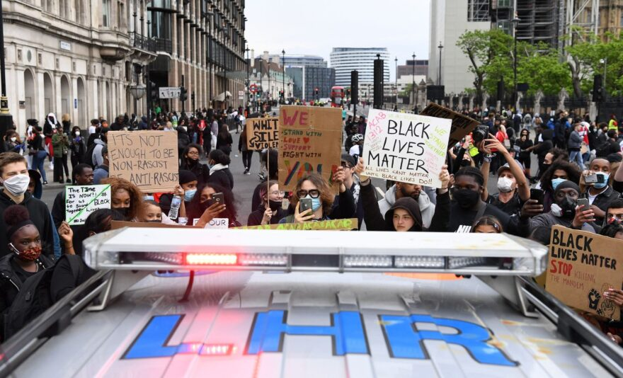 Protesters gather around a police car during an anti-racism demonstration in London, on June 3, 2020, after George Floyd, an unarmed black man died after a police officer knelt on his neck in Minneapolis, Minnesota. (Photo by DANIEL LEAL-OLIVAS / AFP) (Photo by )