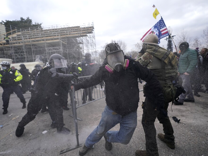 Trump supporters try to break through a police barrier during protests at the U.S. Capitol today, prompting U.S. Capitol Police to take further security measures.