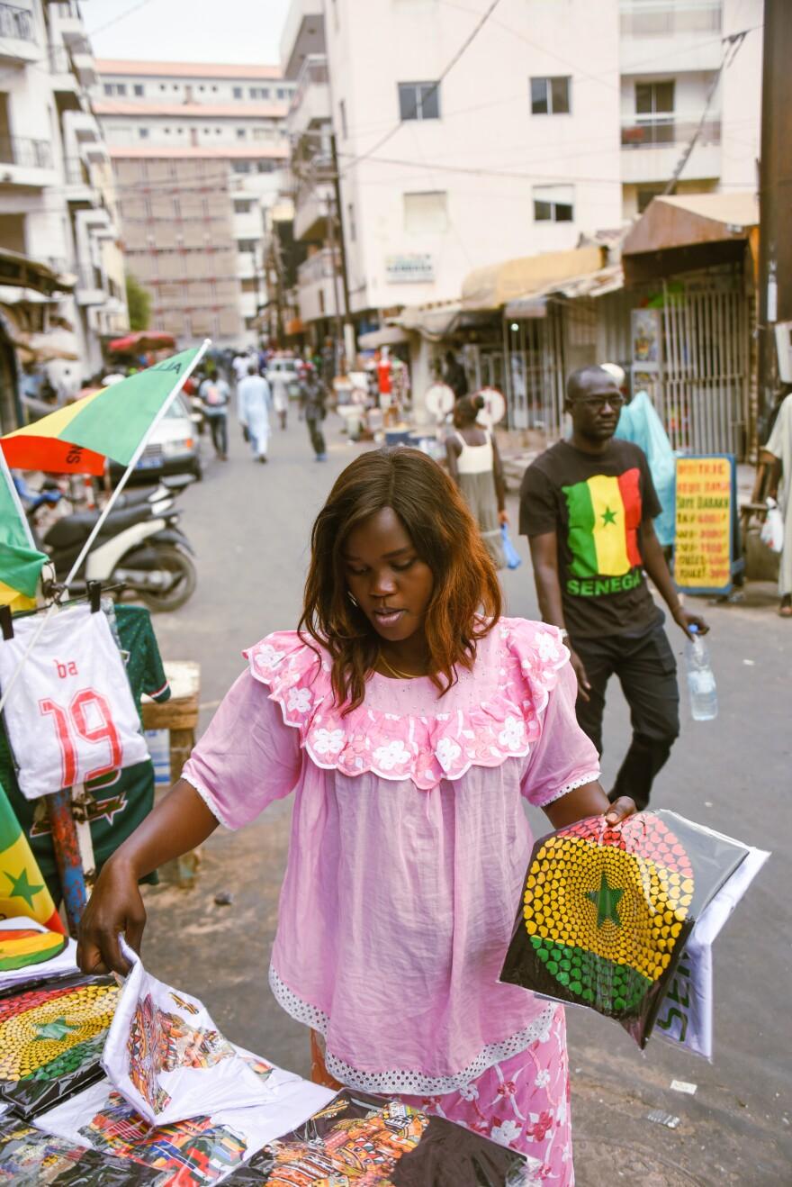 Mame Fatou Dieng sells jerseys, T-shirts, flags and other Senegal team paraphernalia in Dakar's Sandaga Market.