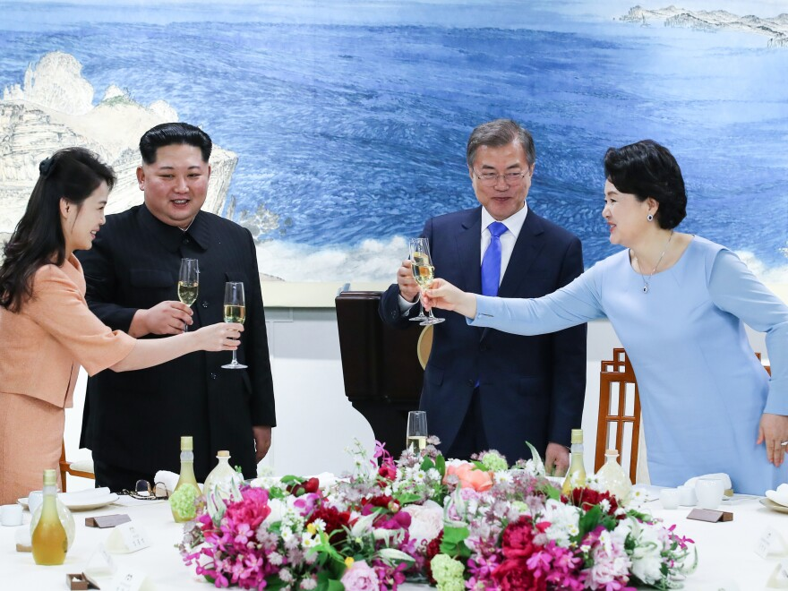Kim and his wife, Ri Sol Ju (left), share a toast with Moon and his wife, Kim Jung-sook, during the official dinner at the end of their historic summit Friday.