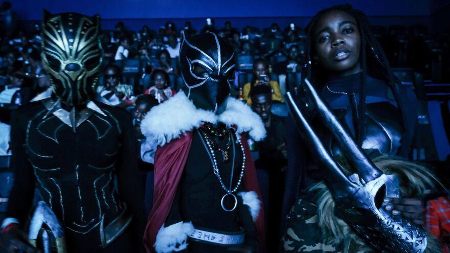 Costumed viewers pose before watching <em>Black Panther</em> in Nairobi, Kenya, on Wednesday.