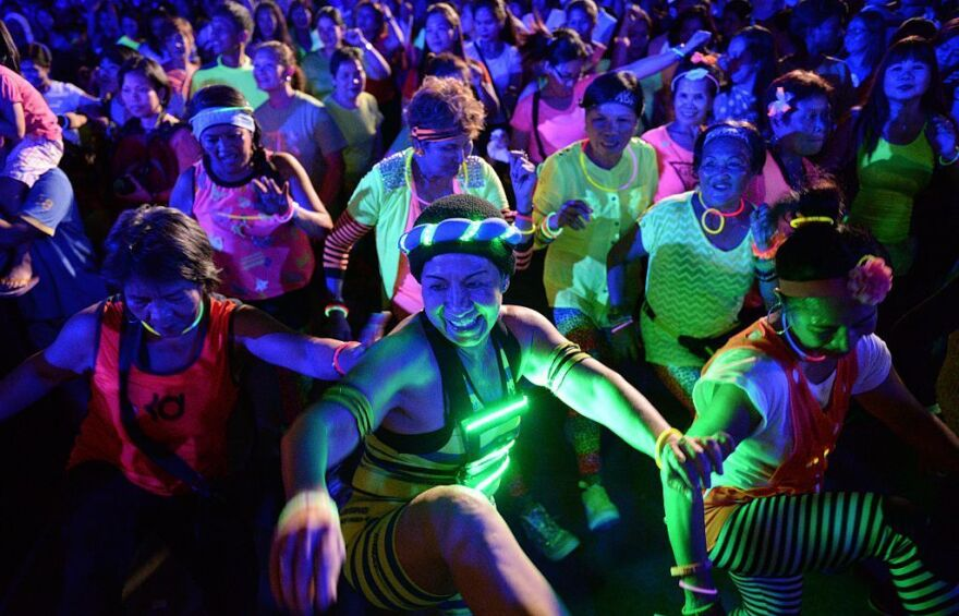 Elderly women dance in a zumba dance during the global climate change awareness campaign Earth Hour at a park in Manila in 2015.