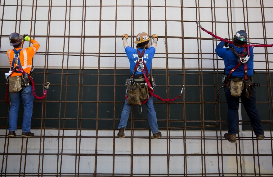 Ironworkers practice tying rebar at the Iron Workers Local Union #86 Administrative Offices in Tukwila, Wash.