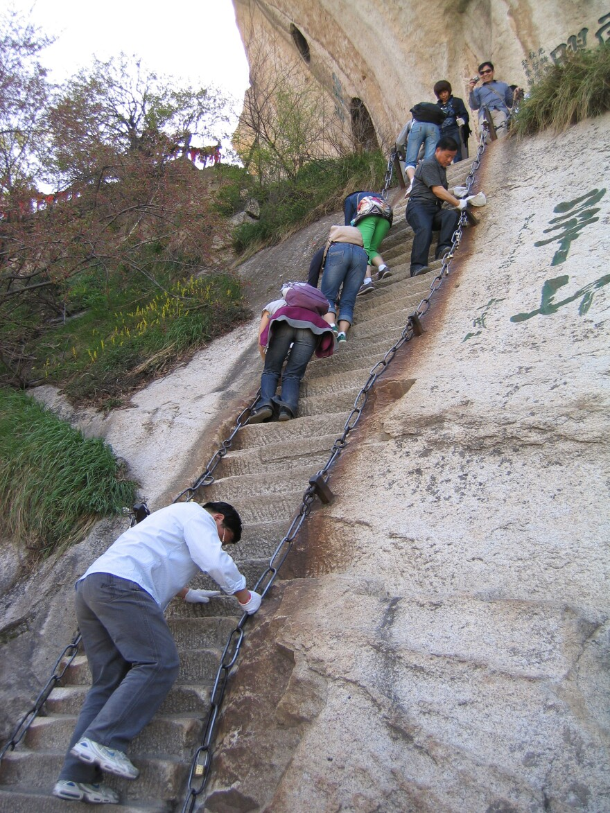 There are many footholds and steep staircases carved into the mountain itself.