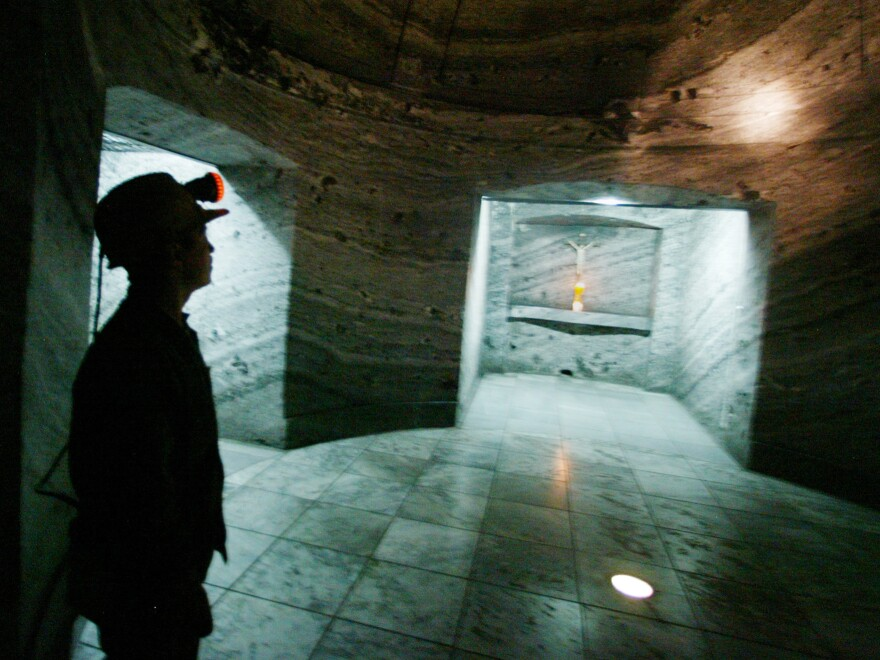 A worker looks for scratches at the Salt Cathedral in 2003.