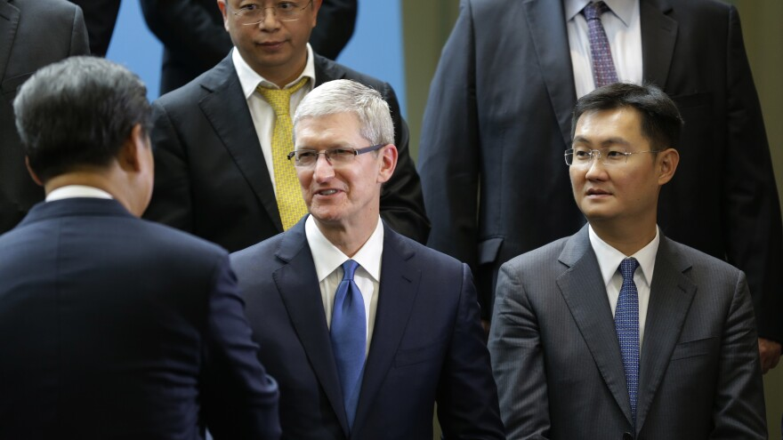 Pony Ma, founder and CEO of Tencent, stands far right as Tim Cook, CEO of Apple, shakes the hand of Chinese President Xi Jinping.