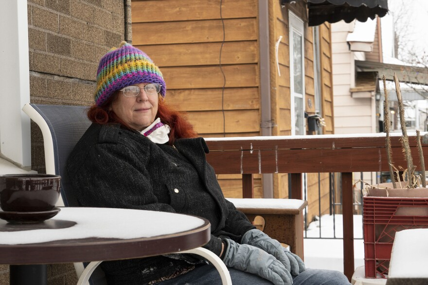 Sandra Griffin sits on her porch in St. Louis. The state of Missouri is demanding that more than 46,000 people pay back unemployment benefits they received. In December, the state told Griffin she owed nearly $8,000.