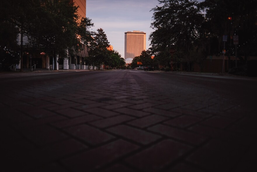 Florida's Capitol building is the background. An Empty brick road is in the foreground.