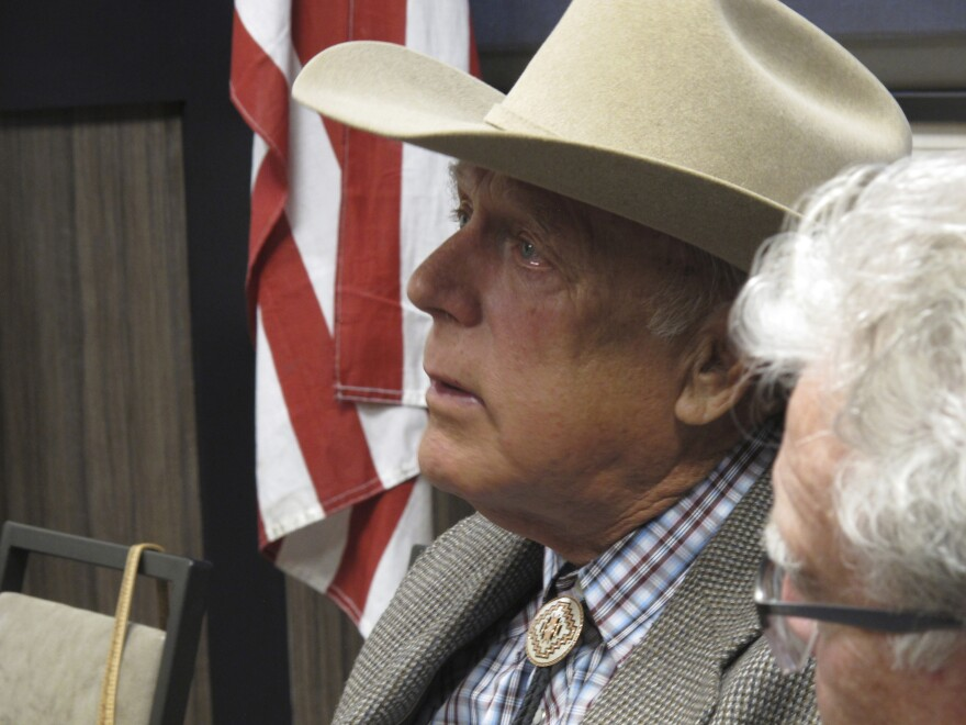 Cliven Bundy listens to other speakers before giving the keynote address to the state convention of the Independent American Party of Nevada, in February 2018.