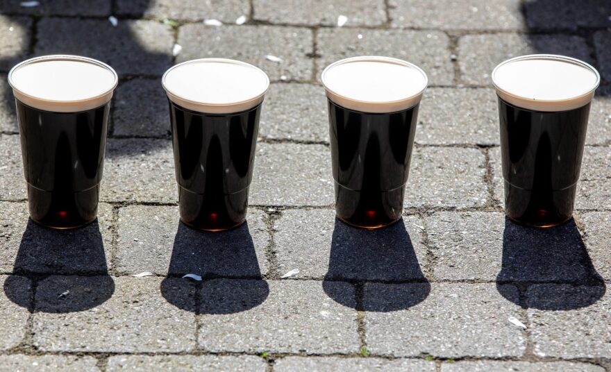 Pints of freshly poured Guinness, poured from the back of the Hatfield House pub's converted delivery van, sit on the pavement before being collected by customers, after being delivered, to a customers' front door, in Belfast, Northern Ireland.