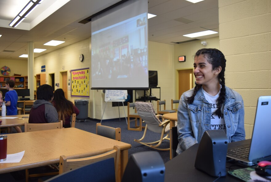 Rawan Nasir speaks to another classroom over video chat during a game of Mystery Skype at Glasgow Middle School.