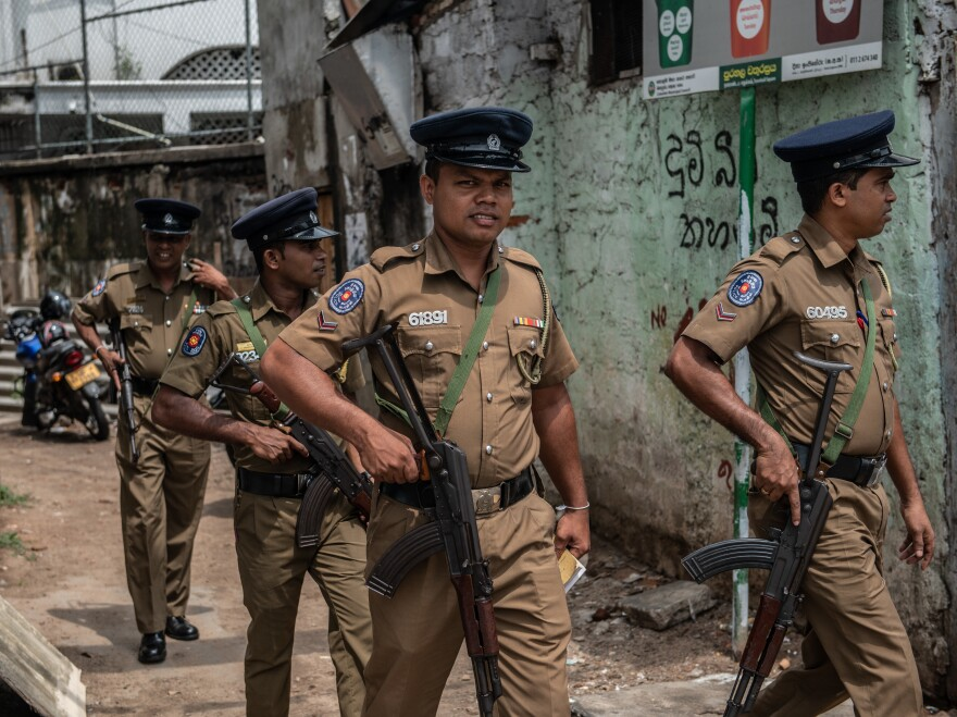Police officers patrol the area around Dawatagaha mosque ahead of prayers on Friday in Colombo, Sri Lanka.