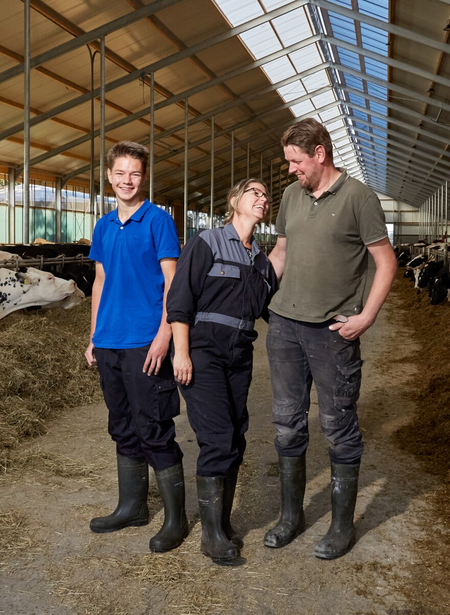 Pastoor stands in her cow shed with her oldest son, Thomas, left, and her husband, Jaap. Thomas, 17, is studying farming and plans on taking over the family farm. When schools were shut due to the lockdown, Pastoor made sure her kids kept up with their schoolwork.