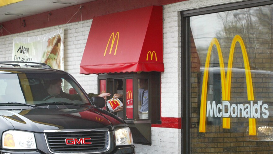 More cities are passing legislation to ban the construction of drive-through windows in an attempt to curb emissions, reduce litter and improve pedestrian safety. The bans are also sometimes touted as a way to help fight obesity, but past studies suggest they don't have that effect.