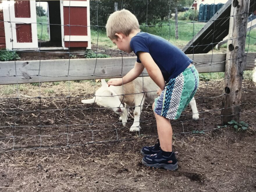 "Five-year-old Jack Sawyer at a farm stand near his hometown of Poultney, Vt. Sawyer's mother, Lyn Wolk, says the public knows her son only through news stories: ""The Jack that they see is the Jack in handcuffs and shackles. ... They don't see the other sides of Jack."""