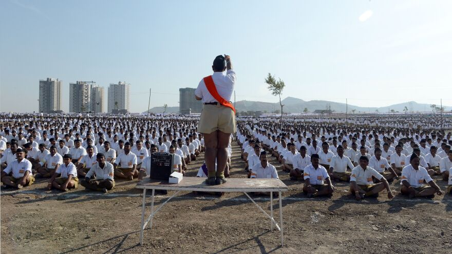RSS members sit in formation as they listen to instructions at a rally in Pune in 2016.