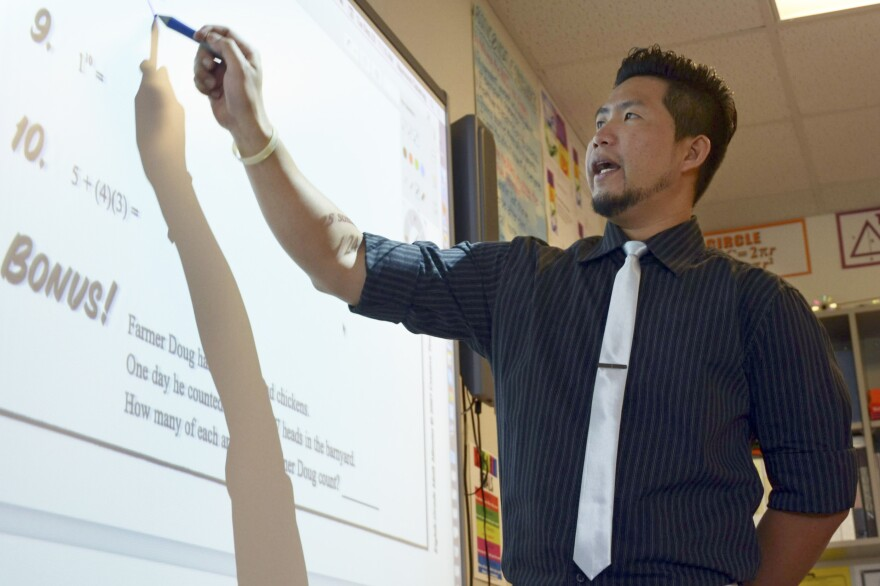 "Raymond Cabahug moved from the Philippines to teach math in the U.S. He likes life in ""peaceful"" Bethune, Colo."