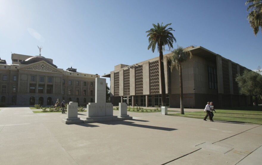 In 2010, Arizona sold 22 buildings in its state capitol complex to help deal with budget deficits. Gov. Jan Brewer recently asked representatives to buy back three of the buildings, including the State House of Representatives (right), as the state's financial situation has improved. The Old Arizona Capitol Building (left) was not part of the deal.