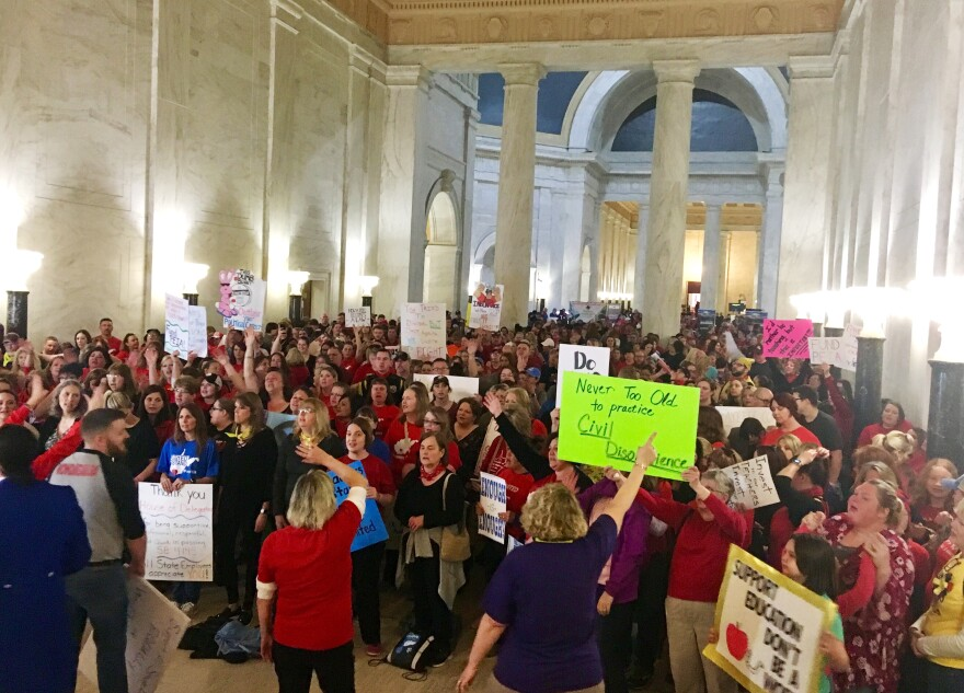 Teachers rally outside the state Senate chambers at the Capitol in Charleston, W.Va., on Thursday, March 1, 2018.