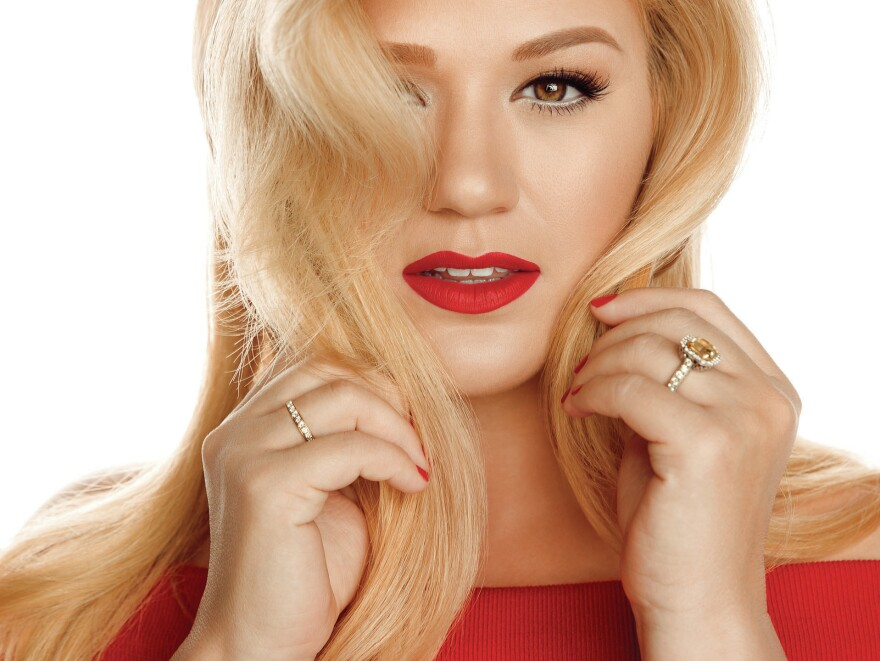 Kelly Clarkson's new holiday album is titled <em>Wrapped in Red</em>.