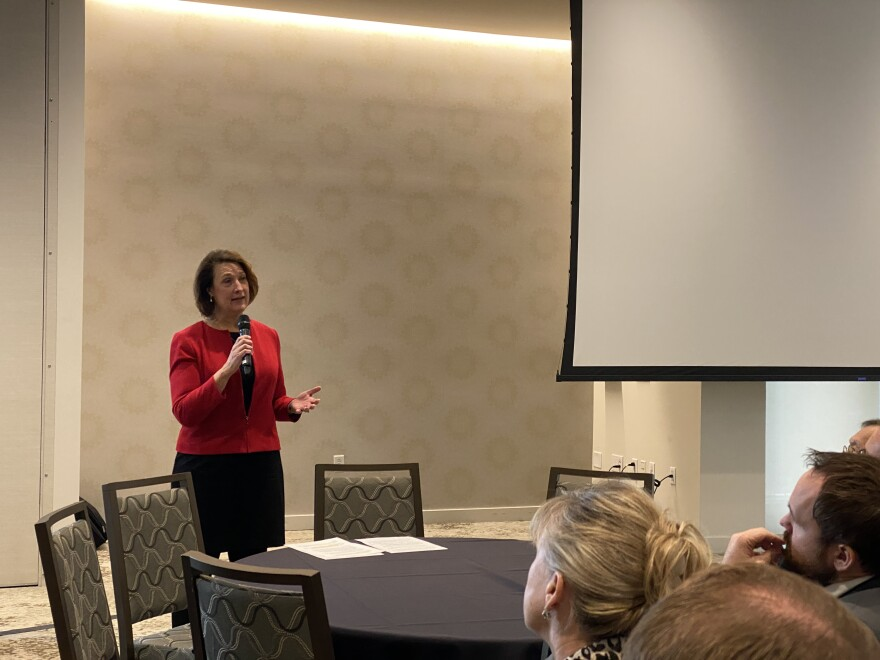 Photo of a woman speaking at the forum.