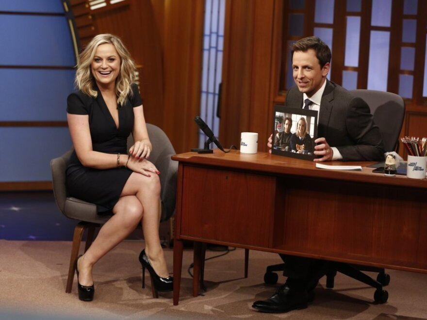 Actress Amy Poehler during an interview with host Seth Meyers on the premiere of Meyers' <em>Late Night</em>.
