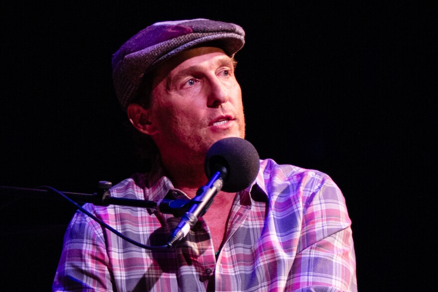Matthew McConaughey plays game on <em>Ask Me Another</em> at the Paramount Theatre in Austin, Texas.