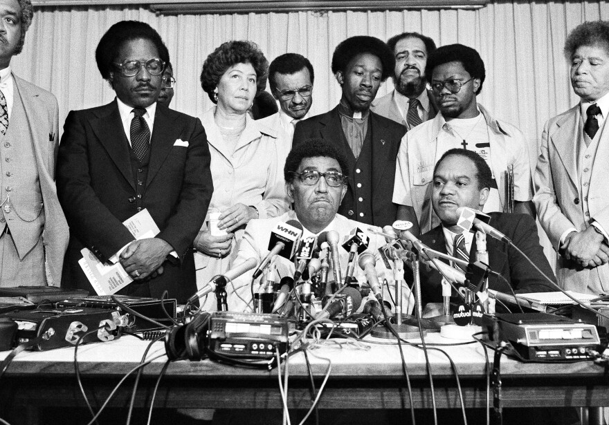 Southern Christian Leadership Conference President Dr. Joseph E. Lowery seated center, at a press conference at the U.N. Church Center in New York, 1979.