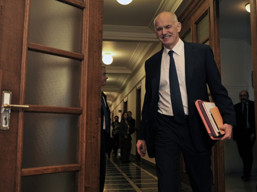 Greek Prime Minister George Papandreou heads to a cabinet meeting in Athens earlier today (Nov. 3, 2011).