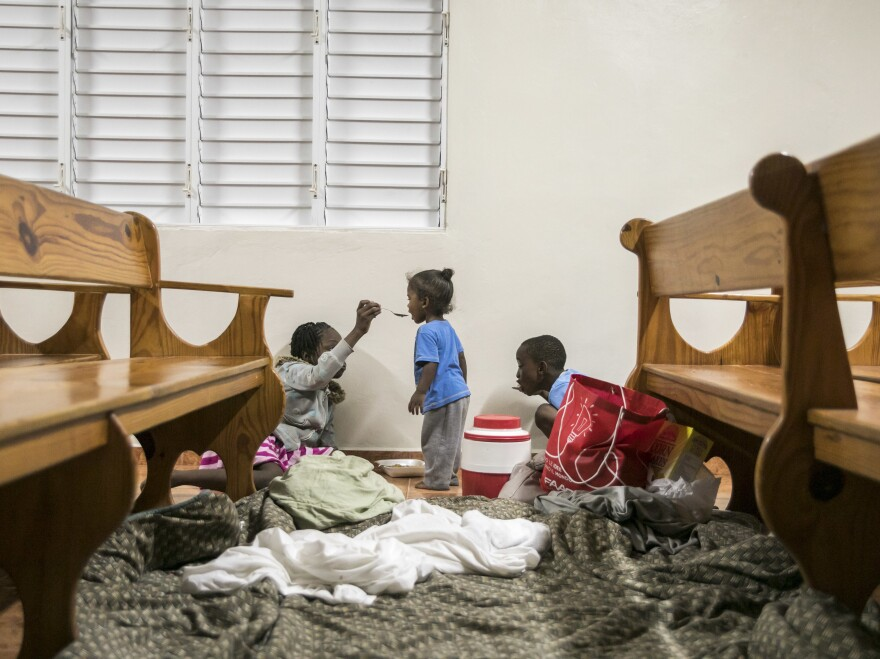 Kids have dinner at a shelter in a local church during the evening before the arrival of Hurricane Irma in Las Terrenas, Dominican Republic, on Wednesday.