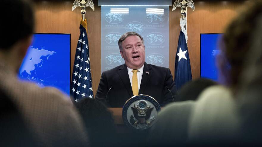 """Secretary of State Mike Pompeo briefs the media last month in Washington, D.C. Pompeo said Friday that the upcoming sanctions snapback aims """"to compel Iran to permanently abandon its well-documented outlaw activities."""""""
