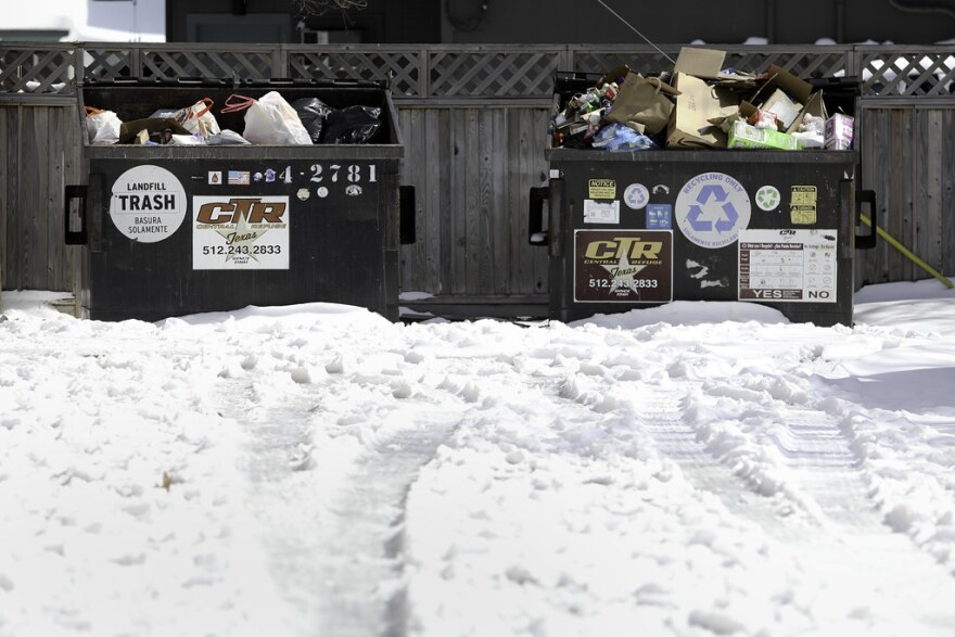 Uncollected trash and recycling piles up in the Hyde Park neighborhood of Austin on Tuesday.