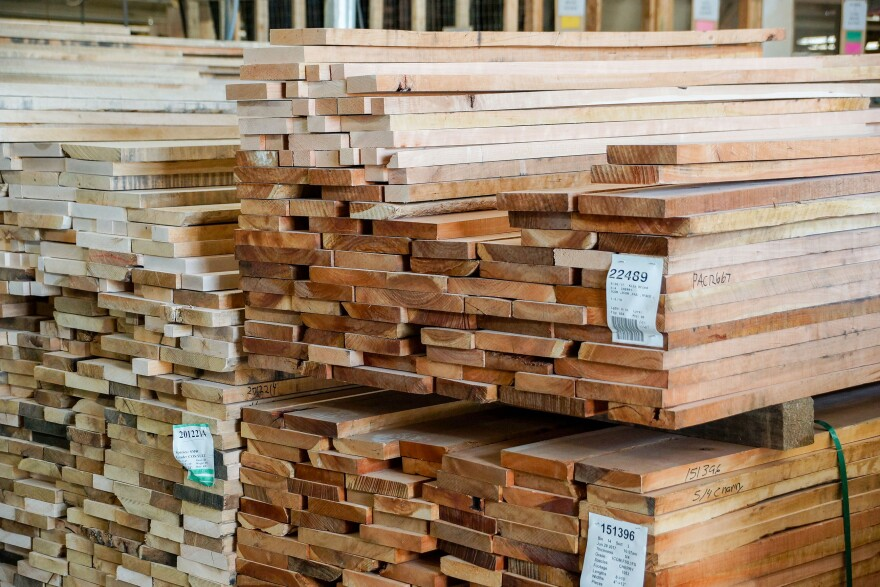 Dried lumber arrives at Gat Creek.  Workers sort through each board by hand.