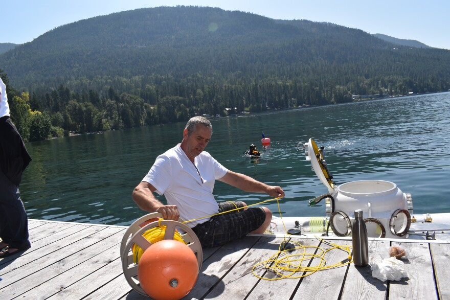 Pilot of the Nekton Gamma, Hank Pronk, gets his safety buoy ready before he leaves the dock for a dive in Flathead Lake in northwestern Montana.