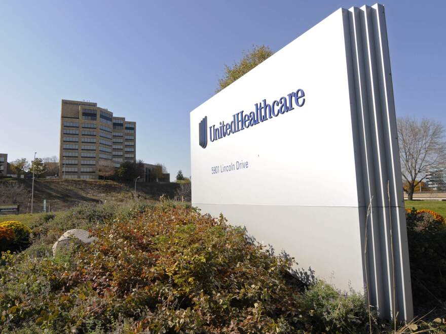 UnitedHealth Group has lowered its earnings forecasts for the year, citing losses on the public insurance exchanges.
