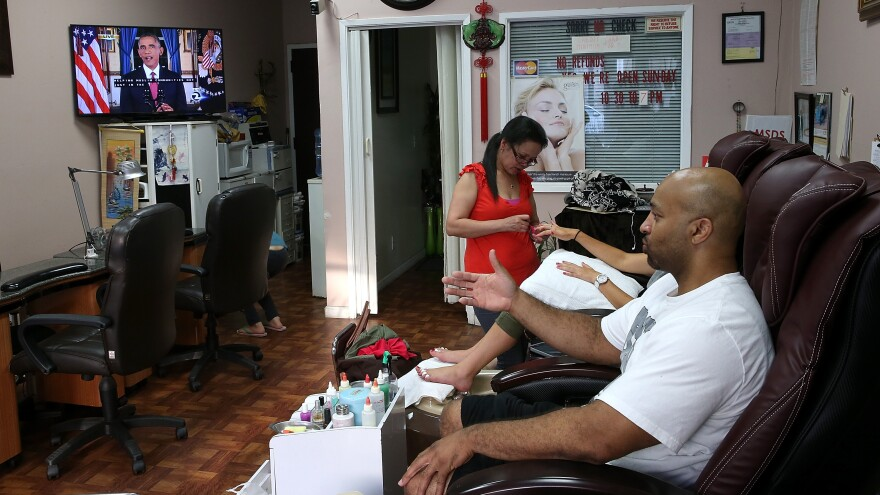 Millions watched President Obama's prime-time address this week, like these patrons of a San Francisco nail salon. But whether Americans will support his plan remains unclear.