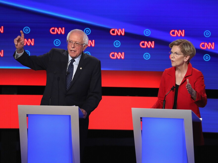 "On the debate stage in Detroit, Sens. Elizabeth Warren and Bernie Sanders were at the center of a heated fight over ""Medicare for All."""