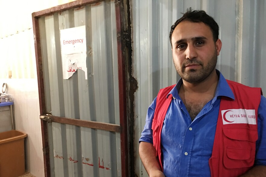 Massoud Ramo, a clinic director with the Kurdish Red Crescent, stands outside the organization's makeshift emergency room at the al-Hol camp.