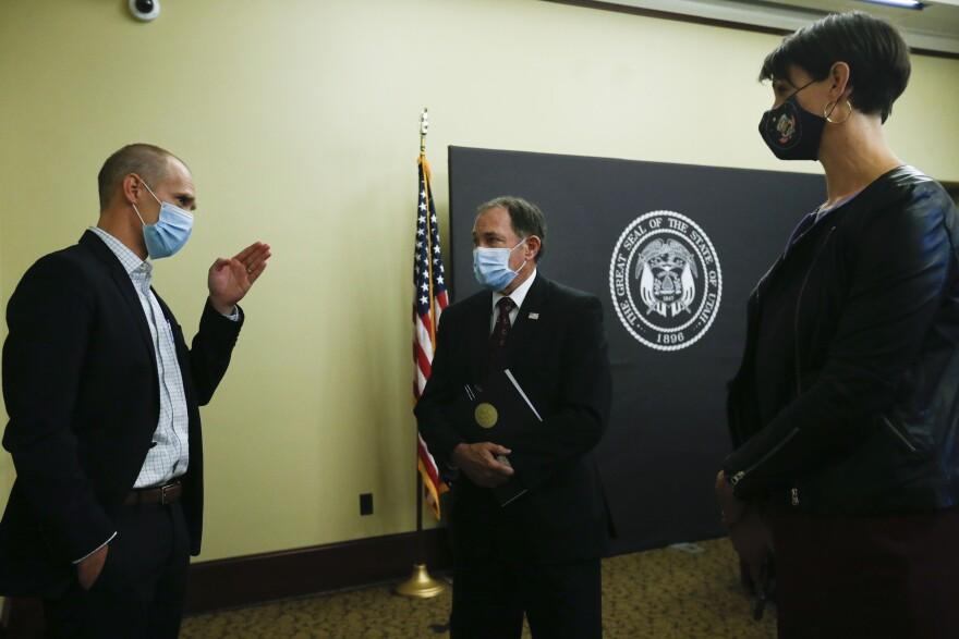 A photo of Gov. Gary Herbert, Dr. Angela Dunn, and Dr. Eddie Stenehjem wearing masks.