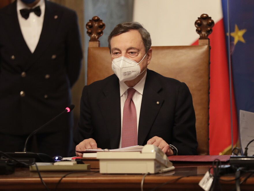 New Italian Prime Minister Mario Draghi presides over a meeting of his first cabinet in Rome Saturday.