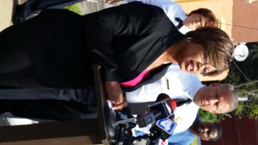 St. Louis Metropolitan Police chief Sam Dotson listens as state Sen. Jamilah Nasheed announces her plans to introduce legislation mandating 10 years in prison for gun crimes in Missouri.