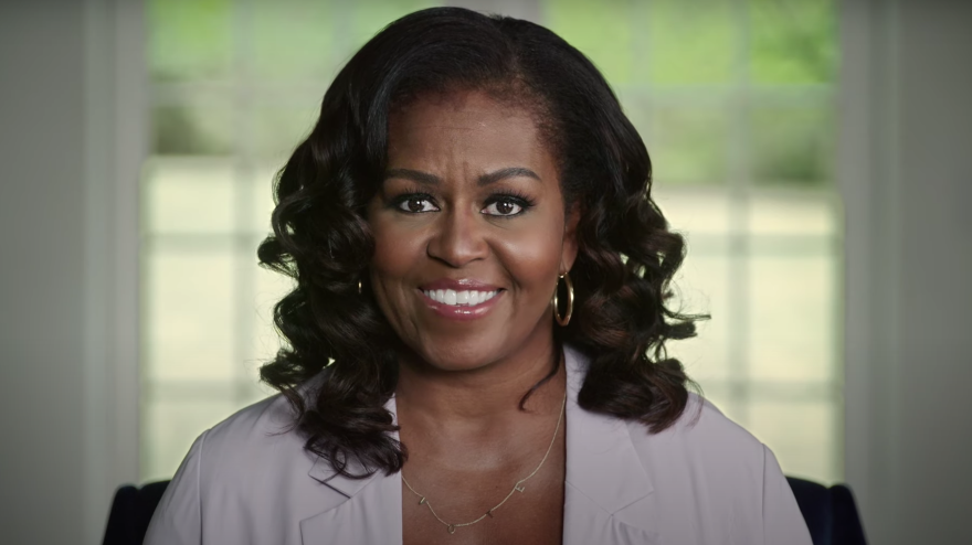 """President Trump """"continues to gaslight the American people by acting like this pandemic is not a real threat,"""" Michelle Obama says in video remarks."""