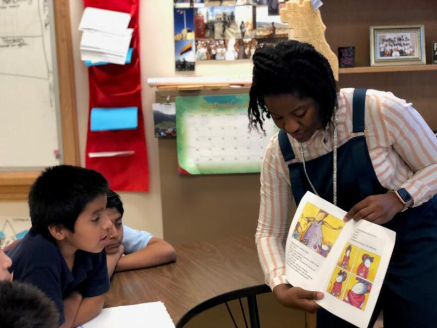 Ivory Smith, a teacher-in-training at RISD Academy in the Richardson Independent School District, reads to fifth-graders. She's enrolled in the Dallas Teacher Residency program.