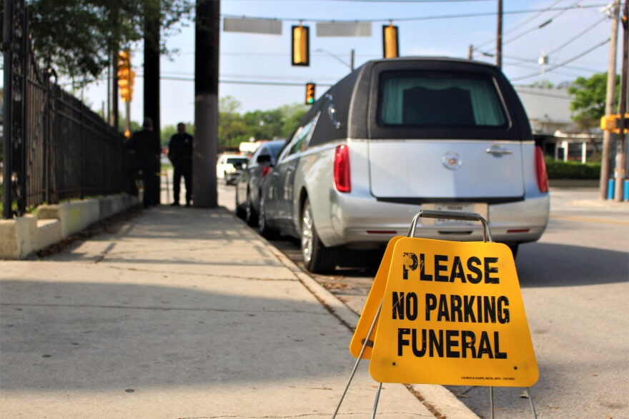 A hearse is parked outside of a funeral home in San Antonio early April 2020.