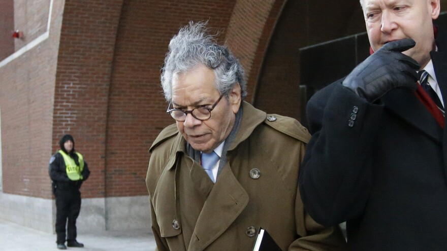 Insys Therapeutics founder John Kapoor (center) departs federal court in Boston in January. The criminal trial of Kapoor and four other executives from the company wrapped up on Friday.