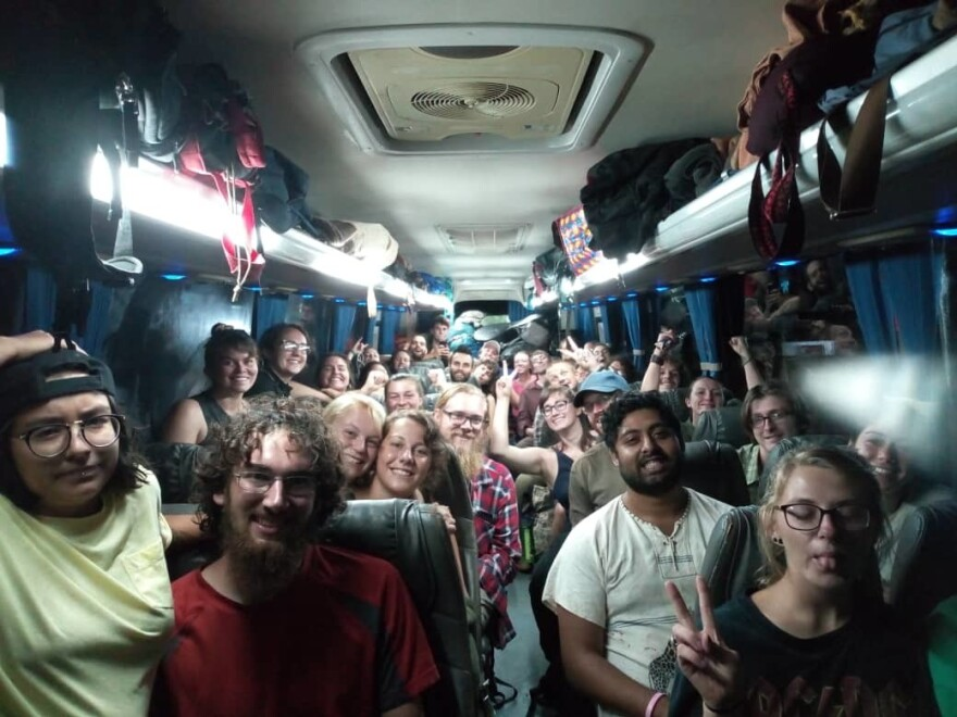 Peace Corps volunteers being evacuated from Zambia wait on the bus at 4 a.m. on March 19 before a 15-hour drive as an early leg of their long journey home.