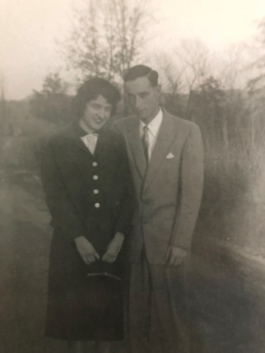 The couple in 1955, posing at their first wedding.