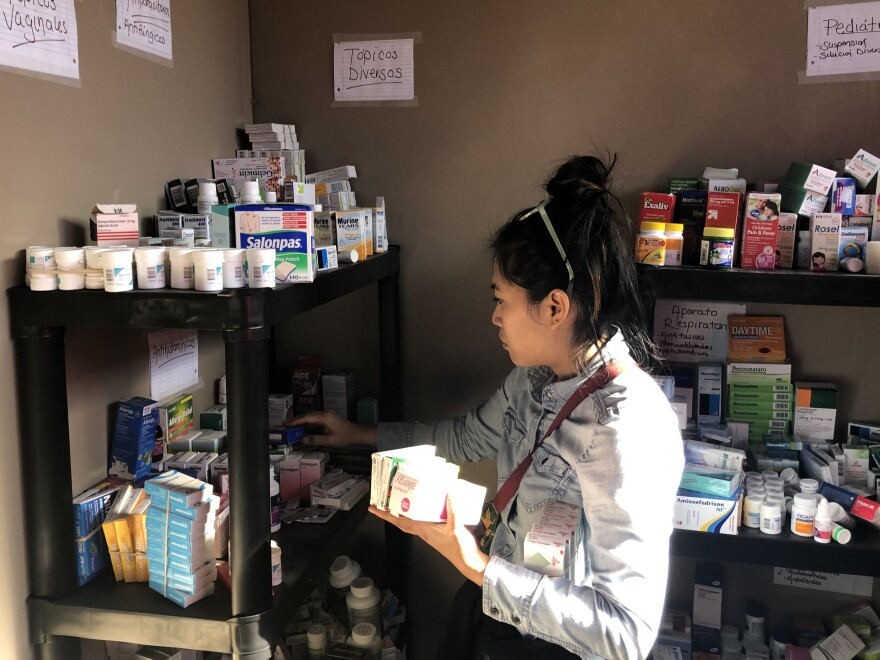 Family medicine Dr. Julie Lu Do of San Diego gathers medicine and supplies before the group heads out to treat migrants. She's part of a group of volunteers who go down to Tijuana weekly to help with health care.